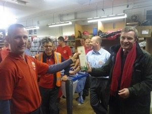 David Jones MP presenting a bottle of House of Commons whisky to the staff of the Royal Mail sorting office in Rhuthun.